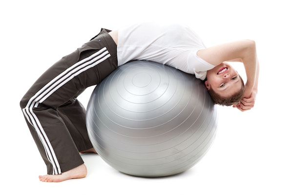 Back stretch on exercise ball